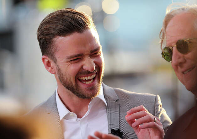 "US actor and singer Justin Timberlake (L) laughs on May 20, 2013 with musician and producer T Bone Burnet as they take part in the show ""Le Grand Journal"" on the set of the French TV Canal+, on the sidelines the 66th Cannes film festival in Cannes. Cannes, one of the world's top film festivals, opened on May 15 and will climax on May 26 with awards selected by a jury headed this year by Hollywood legend Steven Spielberg. Photo: LOIC VENANCE, AFP/Getty Images / 2013 AFP"