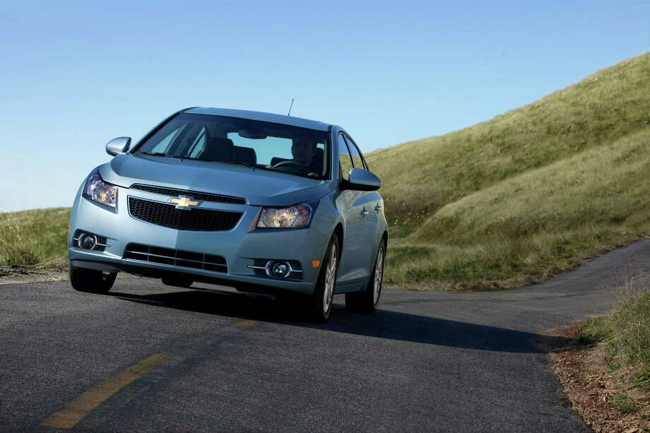 "2013 Chevrolet Cruze LT Price: $20,465 Fuel cost: $10,000 Total: $30,465Source: Cars.com Photo: File / License Agreement - Please read the following important information pertaining to this image. This GM image is protected by copyright and is provided for use under a Creative Commons 3.0 License* for the purpose of editorial comment only. The use of this image for advertising, marketing, or any other commercial purposes is prohibited. This image can be cropped, but may not be altered in any other way, and each should bear the credit line ""© GM Co."" General Motors makes no representations with respect to the consent of those persons appearing in these photos, or with regard to the use of names, trademarks, trade dress, copyrighted designs or works of art or architecture that are not the intellectual property of General Motors.  *The applicable Creative Commons 3.0 License can be found at http://creativecommons.org/licenses/by-nc/3.0"