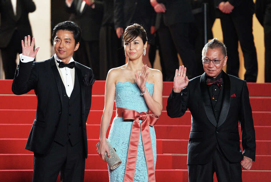(L-R) Takao Osawa, Nanako Matsushima, and Takashi Miike attend the Premiere of 'Wara No Tate' (Shield of Straw) during the 66th Annual Cannes Film Festival at the Palais des Festivals on May 20, 2013 in Cannes, France. Photo: Dominique Charriau, WireImage / 2013 Dominique Charriau