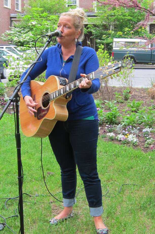 Erin Harkes' early warm up for a gig later that night - the new strings needed breaking in, not rust.