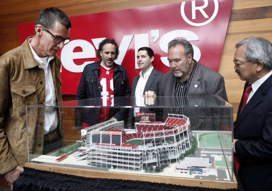 Levi's CEO Chip Bergh, Levi's Brand President James Curleigh, San Francisco 49ers CEO Jed York, Santa Clara Mayor Jamie Matthews and San Francisco Mayor Ed Lee look over a model of the 49ers' new NFL football stadium Wednesday, May 8, 2013 at Levi Strauss corporate headquarters in San Francisco.