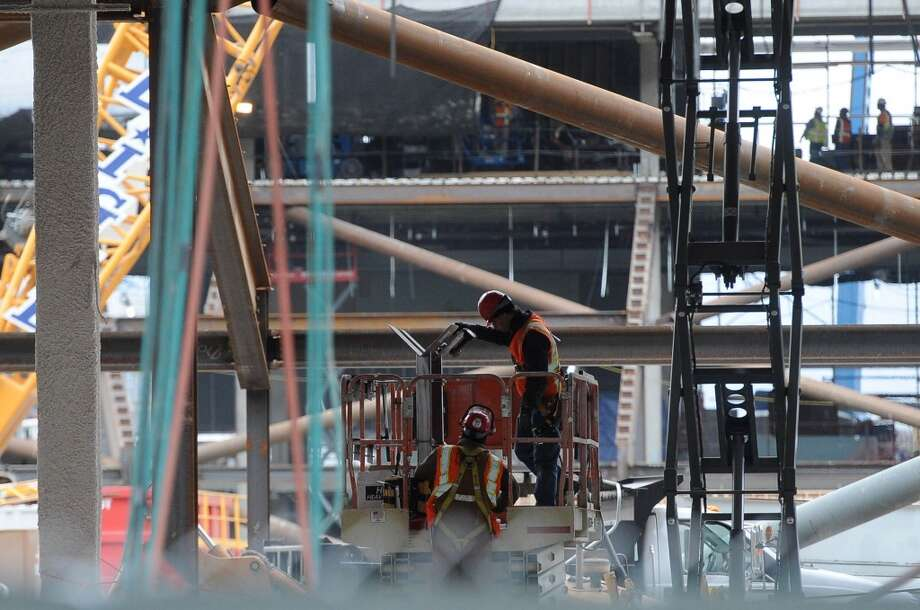 Workers are seen at the new 49ers stadium.