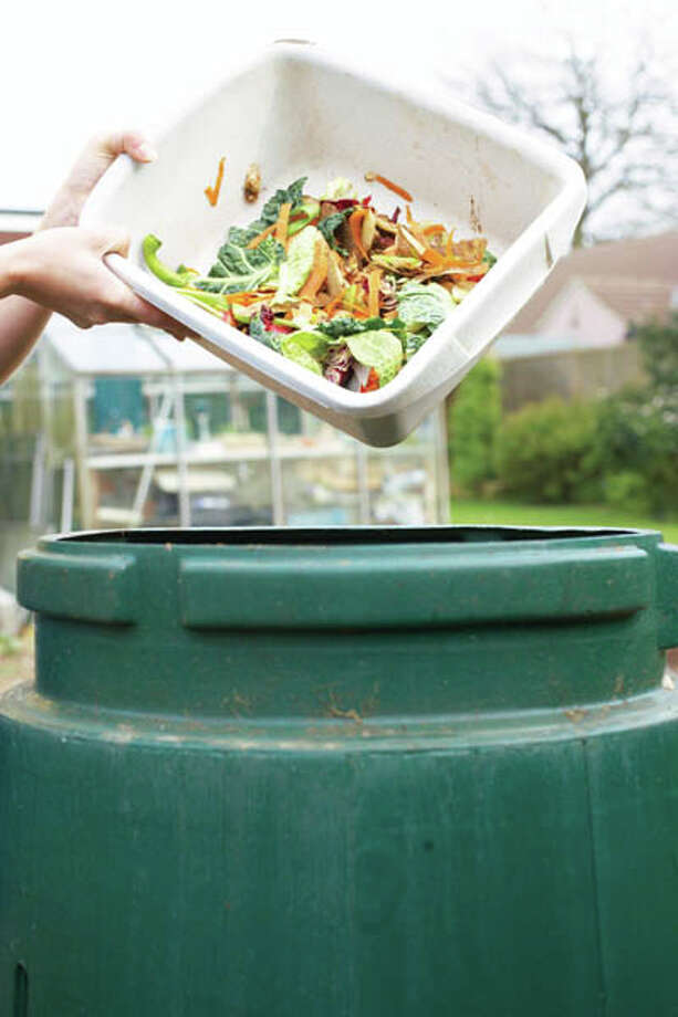 40 percent Composting can reduce homeowner trash at the curb by 25 to 40 percent. Leaves, grass and kitchen scraps represent 30 percent of material that goes to landfills.  source: tinyurl.com/hl13compost Photo: Martin Poole, Getty Images / (c) Martin Poole