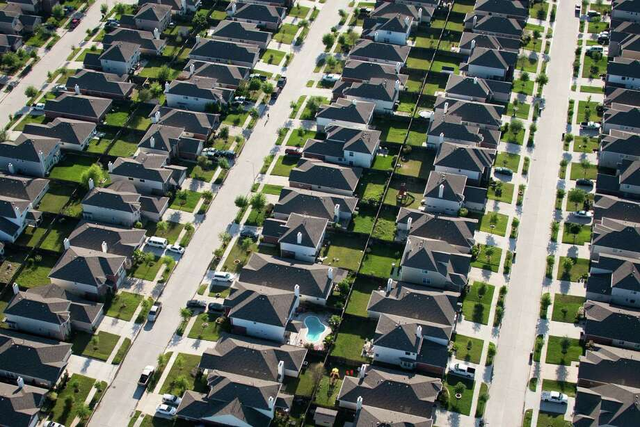 Aerial view of a subdivision in northwest Houston.  More poor people live in the nation's suburbs than in urban cities  because of affordable housing, service-sector jobs and the increased use  of housing vouchers. Photo: Smiley N. Pool, Houston Chronicle / © 2013  Houston Chronicle