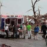 A tornado victim is loaded in an ambulance on Robinson and 142 in south Oklahoma City, Okla., Monday,  May 20, 2013.   (AP Photo/ The Oklahoman,  David McDaniel)