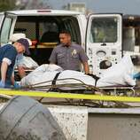 Emergency crews recover a body from the 7-11 store at the corner of Telephone Road and SW 4th Street after a tornado in Moore, Okla. on Monday, May 20, 2013. (AP Photo/Alonzo Adams)