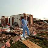 MOORE, OK- MAY 20:  Nathan Ulepich searches outside the back of his house destroyed after a powerful tornado ripped through the area on May 20, 2013 in Moore, Oklahoma. The tornado, reported to be at least EF4 strength and two miles wide, touched down in the Oklahoma City area on Monday killing at least 51 people.