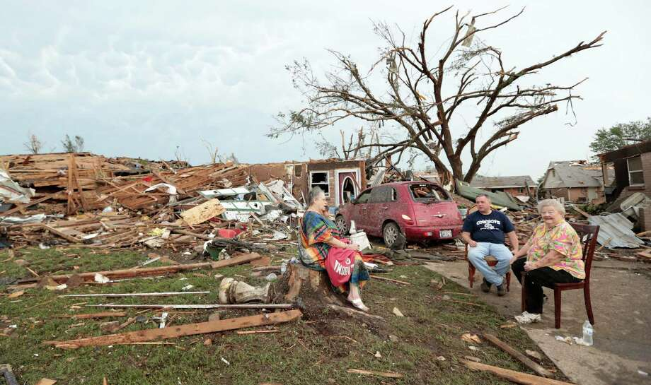 MOORE, OK - MAY 20:  (L - R) Yvonne Barragar, Joe Marshall and Barbara Garcia sit in front of Barragar's destroyed house after a powerful tornado ripped through the area on May 20, 2013 in Moore, Oklahoma. The tornado, reported to be at least EF4 strength and two miles wide, touched down in the Oklahoma City area on Monday killing at least 51 people. Photo: Brett Deering, Getty Images / 2013 Getty Images