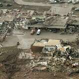This aerial photo shows damage to the Plaza Towers Elementary School after massive tornado hit Moore, Okla., Monday May 20, 2013. (AP Photo/Steve Gooch)