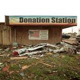 MOORE, OK- MAY 20:  A Goodwill donation station is surrounded by debris after a powerful tornado ripped through the area on May 20, 2013 in Moore, Oklahoma. The tornado, reported to be at least EF4 strength and two miles wide, touched down in the Oklahoma City area on Monday killing at least 51 people.