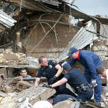 Rescue workers dig through the rubble of a collapsed wall at the Plaza Tower Elementary School to free trapped students in Moore, Okla., following a tornado Monday, May 20, 2013.