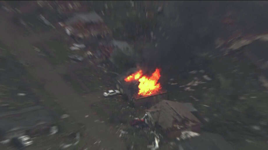 This photo provided by KFOR-TV shows a house fire outside Moore, Okla., Monday, May 20, 2013. A monstrous tornado as much as a mile wide roared through the Oklahoma City suburbs Monday, flattening entire neighborhoods, setting buildings on fire and landing a direct blow on an elementary school. Photo: KFOR-TV, ASSOCIATED PRESS / AP2013