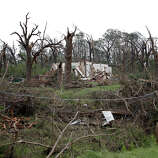 A home sits damaged after a tornado moved through the area May 20, 2013 near Shawnee, Oklahoma. A series of tornados moved across central Oklahoma May 19, killing two people and injuring at least 21.