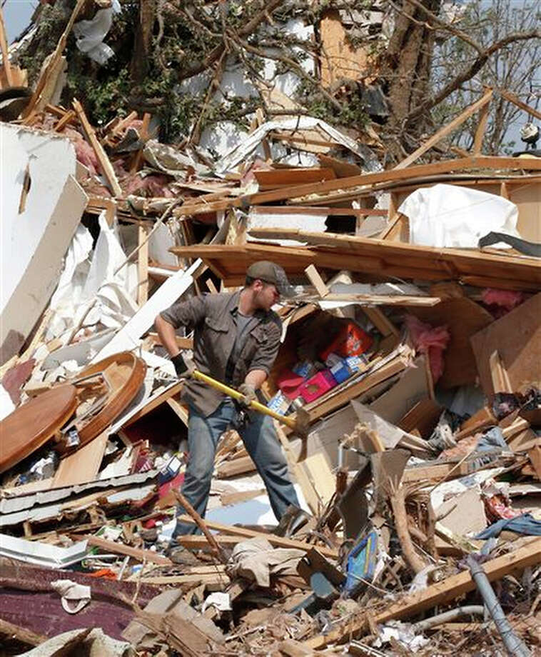 Zach Champion digs through the rubble of his mobile home for his belongings, Monday, May 20, 2013, in the Steelman Estates Mobile Home Park, destroyed in Sunday's tornado, near Shawnee, Okla. Photo: Sue Ogrocki, AP / AP