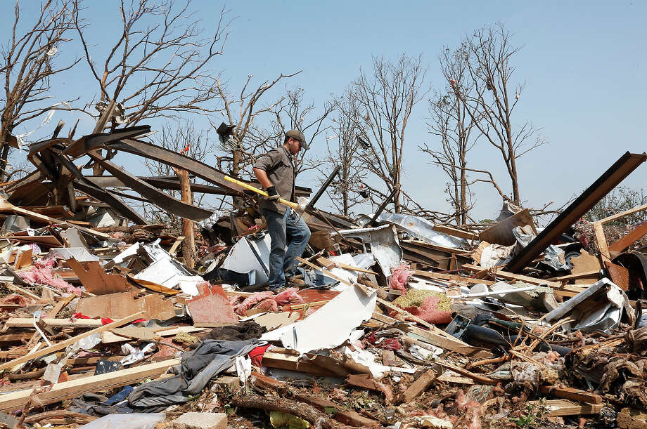 Zach Champion walks through the rubble of his mobile home for his belongings, in the Steelman Estates Mobile Home Park, destroyed in Sunday's tornado, near Shawnee, Okla., Monday, May 20, 2013. Photo: Sue Ogrocki, ASSOCIATED PRESS / AP2013