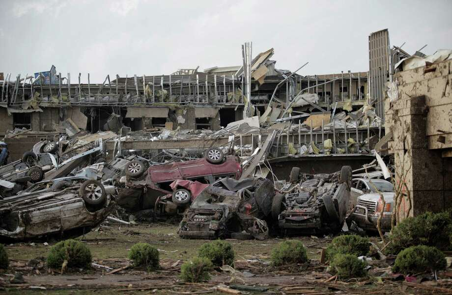 MOORE, OK- MAY 20:   Flipped vehicles are piled up outside the heavily damaged Moore Medical Center after a powerful tornado ripped through the area on May 20, 2013 in Moore, Oklahoma. The tornado, reported to be at least EF4 strength and two miles wide, touched down in the Oklahoma City area on Monday killing at least 51 people. Photo: Brett Deering, Getty Images / 2013 Getty Images