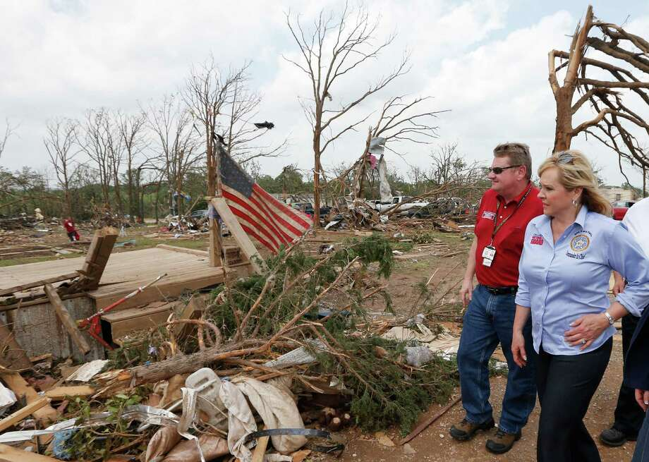 Oklahoma Gov. Mary Fallin, right, walks through the Steelman Estates Mobile Home Park, which was hard hit in Sunday's tornado, with Albert Ashwood, left, Director of the Oklahoma Department of Emergency Management, near Shawnee, Okla., Monday, May 20, 2013. (AP Photo Sue Ogrocki) Photo: Sue Ogrocki, Associated Press / AP