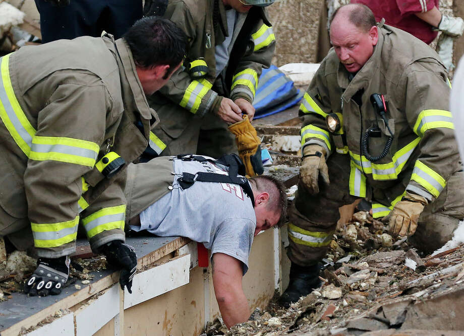 Rescue workers dig through the rubble of a collapsed wall at the Plaza Tower Elementary School to free trapped students in Moore, Okla., following a tornado Monday, May 20, 2013. A tornado as much as a mile (1.6 kilometers) wide with winds up to 200 mph (320 kph) roared through the Oklahoma City suburbs Monday, flattening entire neighborhoods, setting buildings on fire and landing a direct blow on an elementary school. Photo: Sue Ogrocki, ASSOCIATED PRESS / AP2013