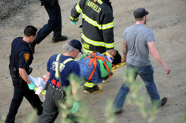 Rescue workers carry on of the injured from the scene of the Friday afternoon collision. Photo: Christian Abraham / Connecticut Post