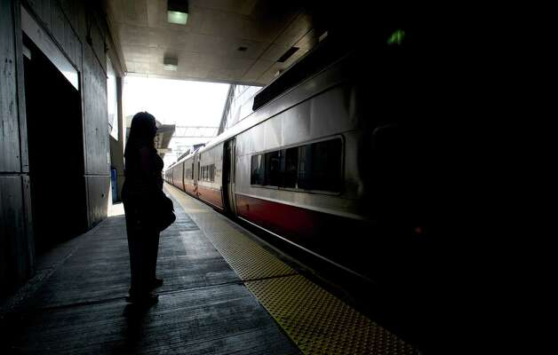 A woman waits for a train at the train station in Stamford, Conn., on Tuesday, May 21, 2013. Photo: Lindsay Perry / Stamford Advocate