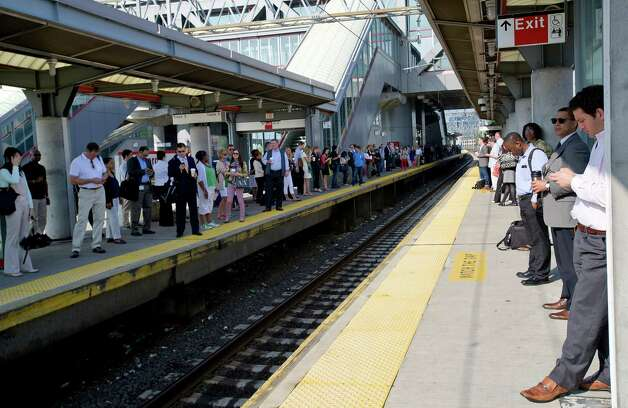 Commuters wait for a train on the platform at the train station in Stamford, Conn., on Tuesday, May 21, 2013. Photo: Lindsay Perry / Stamford Advocate