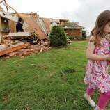 Magen Stanley, 5, walks away from her grandparents destroyed home after a tornado hit the area near 149th and Drexel on Monday, May 20, 2013 in Oklahoma City, Okla.  (AP Photo/ The Oklahoman, Chris Landsberger)