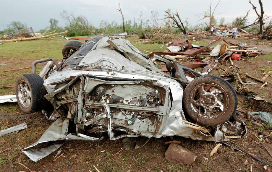 The remains of a car destroyed by a tornado that hit the area near 149th and Drexel on Monday, May 20, 2013 in Oklahoma City, Okla. (AP Photo/ The Oklahoman, Chris Landsberger) Photo: CHRIS LANDSBERGER, Associated Press / The Oklahoman