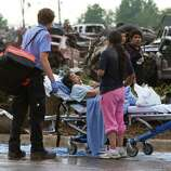 A Moore Medical Center patient sits in the parking lot after a tornado damaged the hospital in Moore, Okla. on Monday, May 20, 2013. (AP Photo/Alonzo Adams)