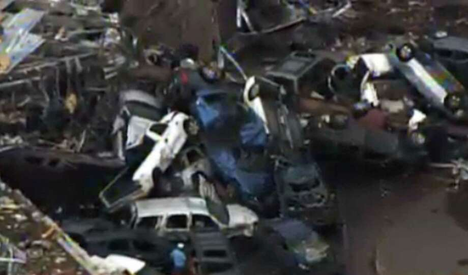 This photo provided by KFOR-TV shows a  car pile-up outside Moore, Okla., Monday, May 20, 2013. A monstrous tornado as much as a mile wide roared through the Oklahoma City suburbs Monday, flattening entire neighborhoods, setting buildings on fire and landing a direct blow on an elementary school. (AP Photo/KFOR-TV) Photo: KFOR-TV, Associated Press / AP