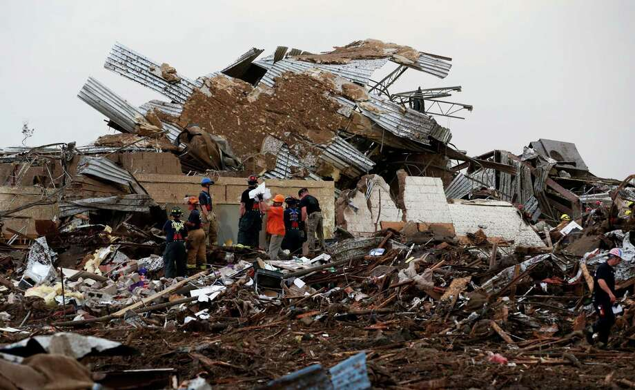 Workers continue to dig through the rubble of Plaza Towers Elementary School after a tornado moved through Moore, Okla., Monday, May 20, 2013. (AP Photo Sue Ogrocki) Photo: Sue Ogrocki, Associated Press / AP