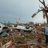 MOORE, OK- MAY 20:  Philip Gotcher stands in the rubble of his house after a powerful tornado ripped through the area on May 20, 2013 in Moore, Oklahoma. The tornado, reported to be at least EF4 strength and two miles wide, touched down in the Oklahoma City area on Monday killing at least 51 people.