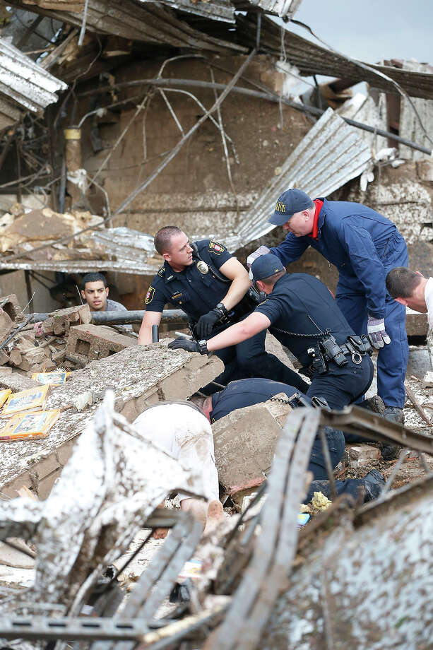 Rescue workers dig through the rubble of a collapsed wall at the Plaza Tower Elementary School to free trapped students in Moore, Okla., following a tornado Monday, May 20, 2013. Photo: Sue Ogrocki, ASSOCIATED PRESS / AP2013