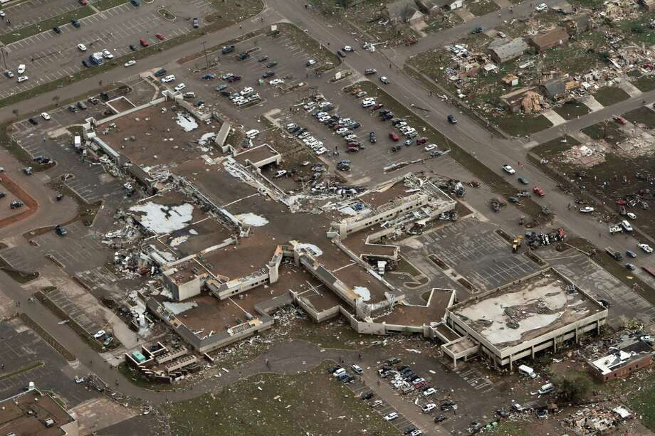 This aerial photo shows damage to Moore Medical Center after it was hit by a massive tornado in Moore, Okla., Monday May 20, 2013. A tornado roared through the Oklahoma City suburbs Monday, flattening entire neighborhoods, setting buildings on fire and landing a direct blow on an elementary school. Photo: AP