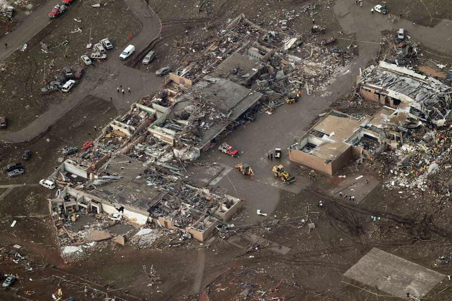 This aerial photo shows damage to Plaza Towers Elementary School after it was hit by a massive tornado in Moore, Okla., Monday May 20, 2013. A tornado roared through the Oklahoma City suburbs Monday, flattening entire neighborhoods, setting buildings on fire and landing a direct blow on an elementary school. Photo: AP