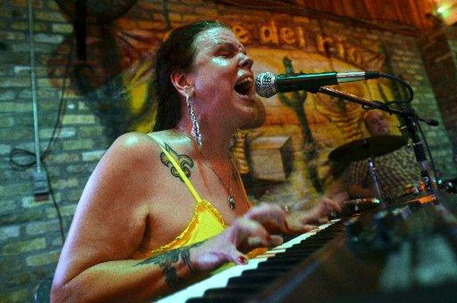 Sue Pierce plays on the patio at Cafe Del Rio, where you can hear live music on Wednesday through Saturday nights. Beth Rankin/cat5