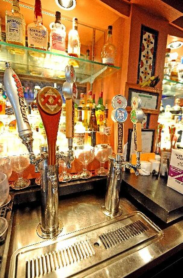 New craft beer taps at Cafe Del Rio's Bar. Randy Edwards/cat5