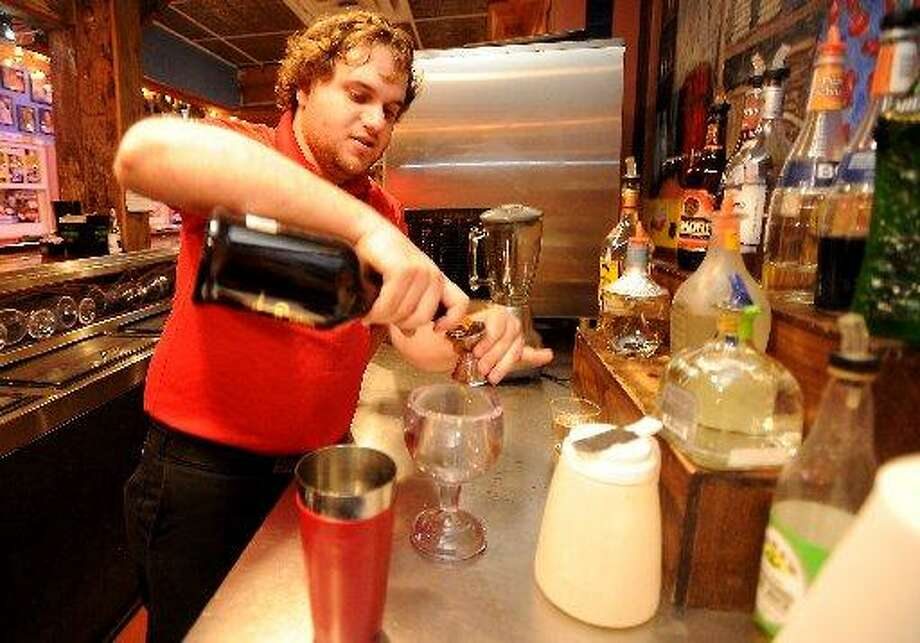 Tom Melanson mixes up a 3G Margarita at Cafe Del Rio in Beaumont
