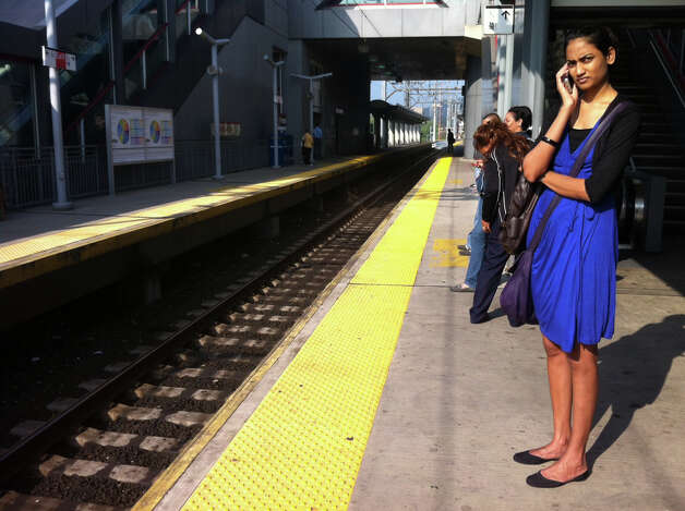 Commuters wait for a train at Stamford Train Station in Stamford, Conn. on Tuesday, May 21, 2013. Photo: Lindsay Perry / Stamford Advocate