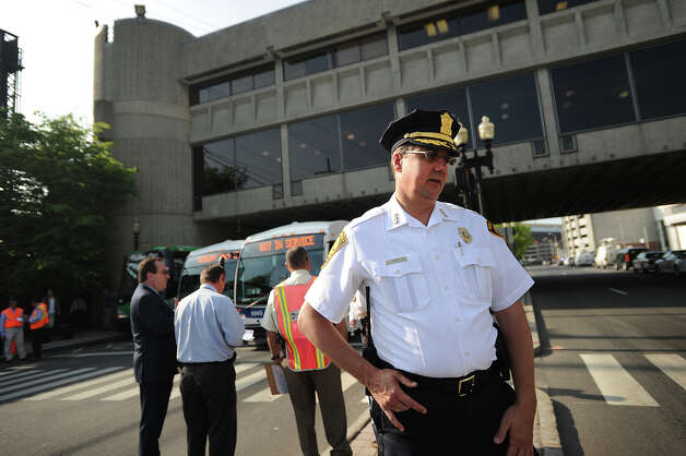 Bridgeport police Chief Joseph Gaudett monitors the situation outside the Bridgeport train station on Water Street in Bridgeport, Conn. on Tuesday, May 21, 2013. Train service is currently suspended between Bridgeport and South Norwalk due to damage caused by Friday's Metro North train derailment and collision. Photo: Brian A. Pounds / Connecticut Post