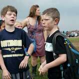 Children wait for their parents to arrive at Briarwood Elementary school after a tornado destroyed the school in south  Oklahoma City, Okla, Monday, May 20, 2013. Near SW 149th and Hudson.  (AP Photo/ The Oklahoman,  Paul Hellstern)