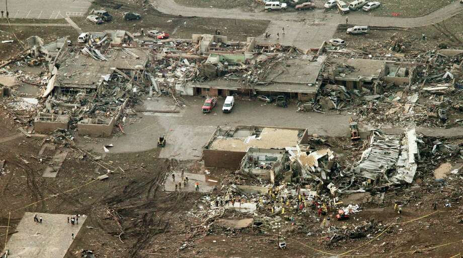 This aerial photo shows damage to the Plaza Towers Elementary School after massive tornado hit Moore, Okla., Monday May 20, 2013. (AP Photo/Steve Gooch) Photo: Steve Gooch, Associated Press / AP