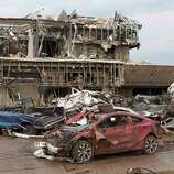 The Moore Medical Center and vehicles lay damaged after a tornado moves through Moore, Okla. on Monday, May 20, 2013. (AP Photo/Alonzo Adams)