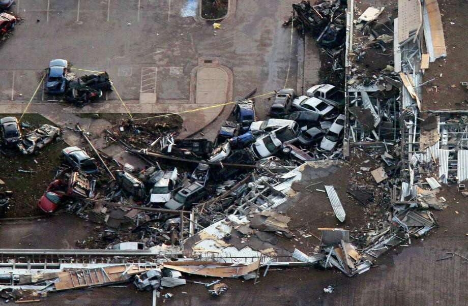 This aerial photo shows the Moore Medical center in Moore, Okla., following a tornado Monday, May 20, 2013. A tornado roared through the Oklahoma City suburbs Monday, flattening entire neighborhoods, setting buildings on fire and landing a direct blow on an elementary school. (AP Photo/Steve Gooch) Photo: Steve Gooch, Associated Press / AP