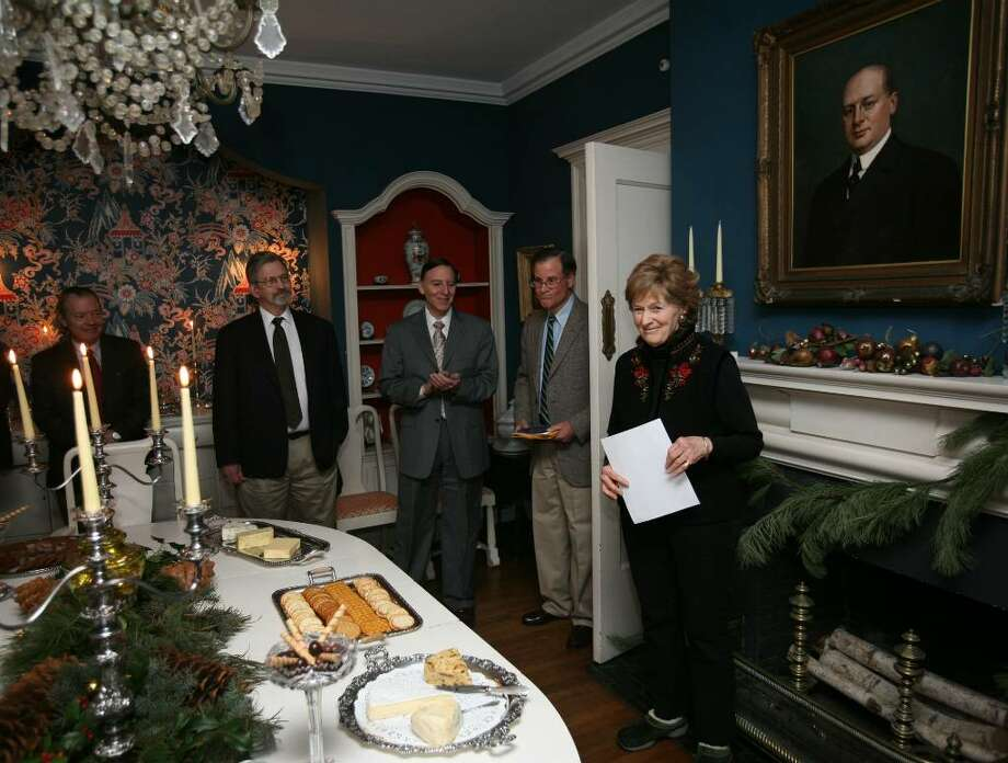 Ellen Sturges, right, announces that her family home, Restmore, at 375 Warner Hill Road in Fairfield, received a listing on the National Register of Historic Places. From left are DeVer Warner, researcherTod Bryant, Fairfield First Selectman Ken Flatto, David Sturges, and Ellen Sturges. On the wall behind Sturges is a portrait of her grandfather, Charles Barnum Read, of Read's Department Store in downtown Bridgeport. Photo: Brian A. Pounds / Connecticut Post