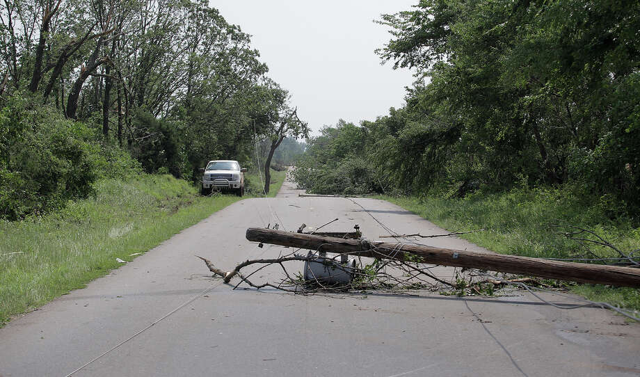 An electrical pole lies on a Pottawatomie County road after a tornado May 20, 2013 near Shawnee, Oklahoma. A series of tornados moved across central Oklahoma May 19, killing two people and injuring at least 21. Photo: Brett Deering, Getty Images / 2013 Getty Images