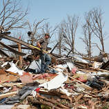 Zach Champion walks through the rubble of his mobile home for his belongings, in the Steelman Estates Mobile Home Park, destroyed in Sunday's tornado, near Shawnee, Okla., Monday, May 20, 2013.