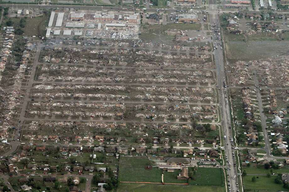 This aerial photo shows the remains of homes hit by a massive tornado in Moore, Okla., Monday May 20, 2013. A tornado roared through the Oklahoma City suburbs Monday, flattening entire neighborhoods, setting buildings on fire and landing a direct blow on an elementary school. Photo: AP