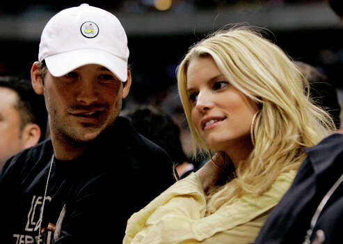 In this March 18, 2008, file photo, Dallas Cowboys quarterback Tony Romo, left, and actor Jessica Simpson, right, take in an NBA basketball game between the Los Angeles Lakers and Dallas Mavericks in Dallas. Photo: Tony Gutierrez, Associated Press / AP