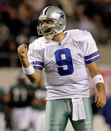 Cowboys quarterback Tony Romo pumps his fist in celebration of a passing touchdown in the second qua