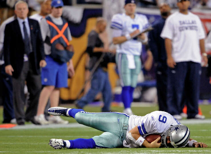 Cowboys quarterback Tony Romo is sacked during the second half of an NFL divisional playoff football